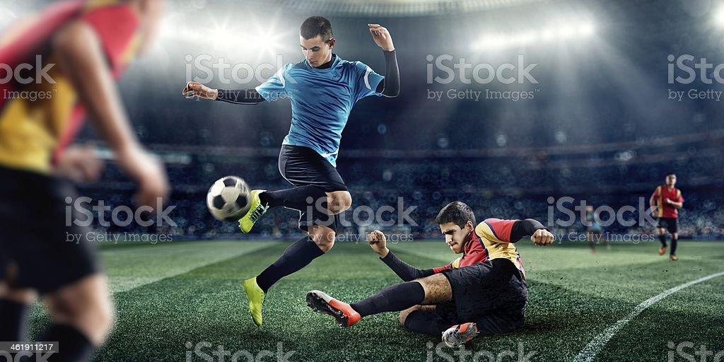 Joueurs de football dans le stade - Photo
