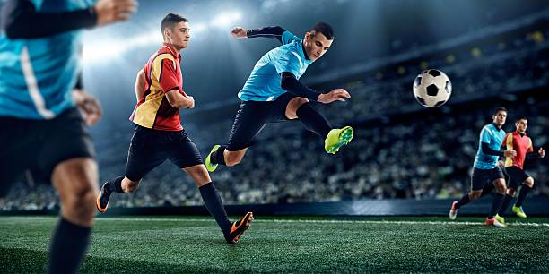 soccer players in stadium - soccer competition stock photos and pictures