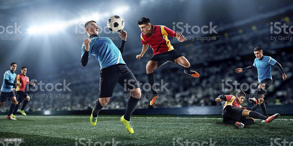 Soccer players in stadium stock photo