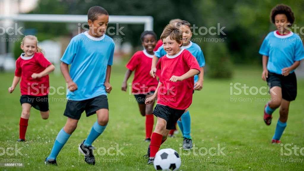 Soccer Players Kicking the Ball stock photo