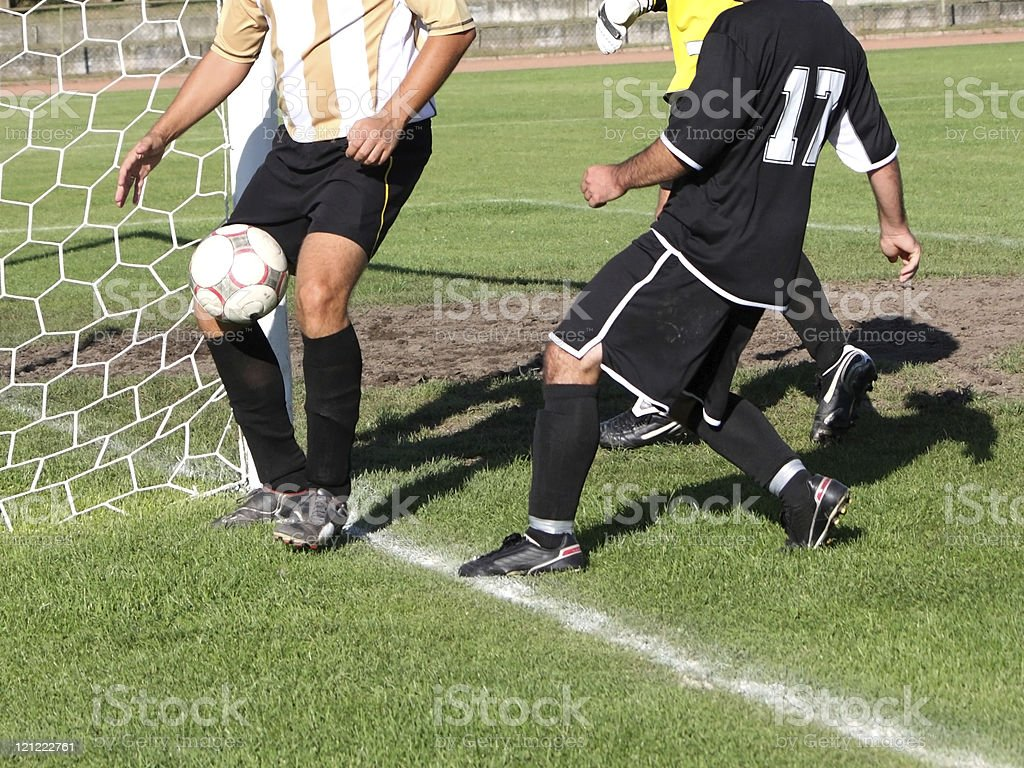 soccer players near goal royalty-free stock photo