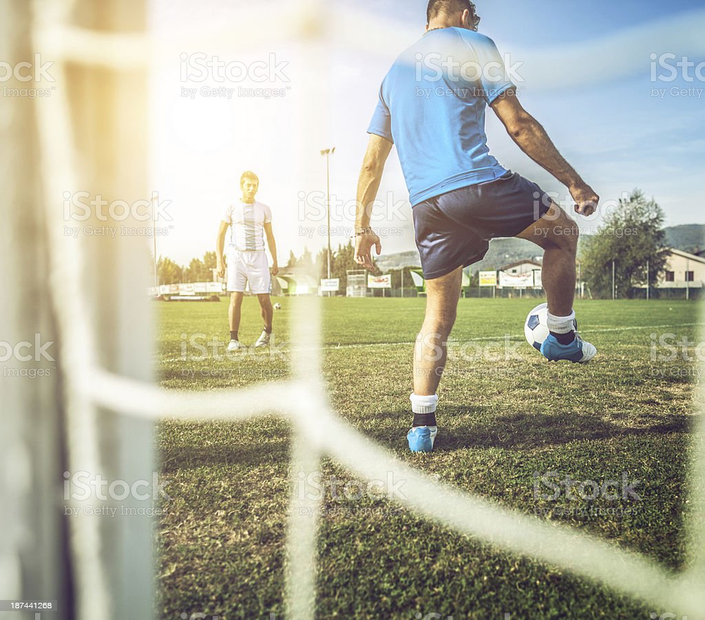 Soccer players on the football pitch royalty-free stock photo