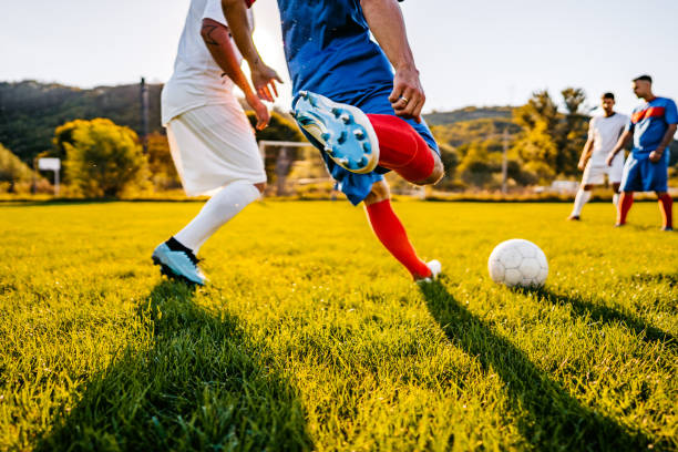 Soccer players playing football stock photo