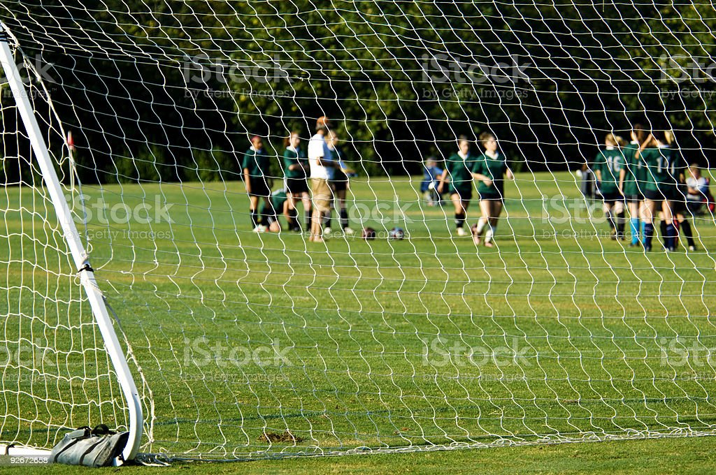 Soccer Players playing Soccer on Soccer Field with Soccer Ball