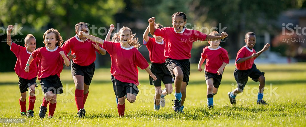 Soccer Players Running and Cheering stock photo