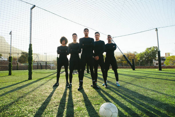 Soccer players standing together on pitch stock photo