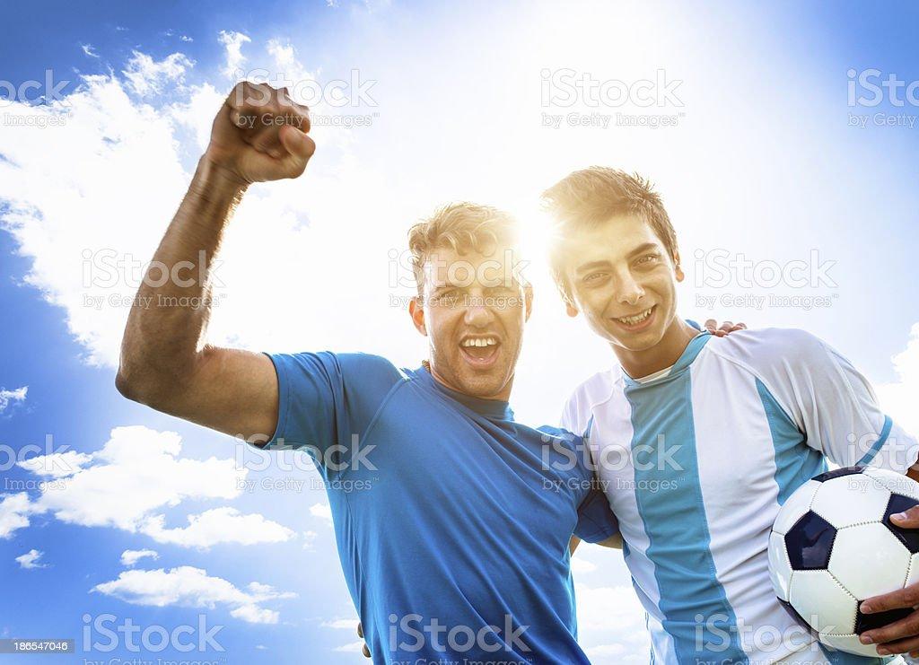Soccer players winning stock photo