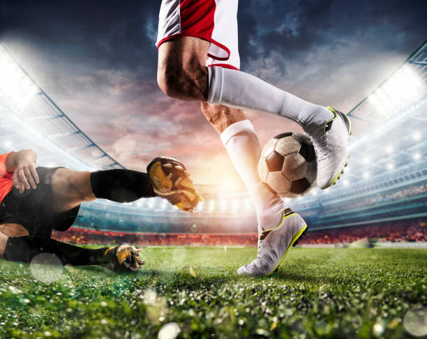 Soccer players with soccerball at the stadium during the match - foto stock