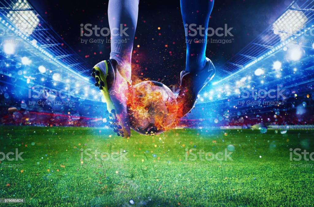 Soccer players with soccerball on fire at the stadium during the match foto stock royalty-free