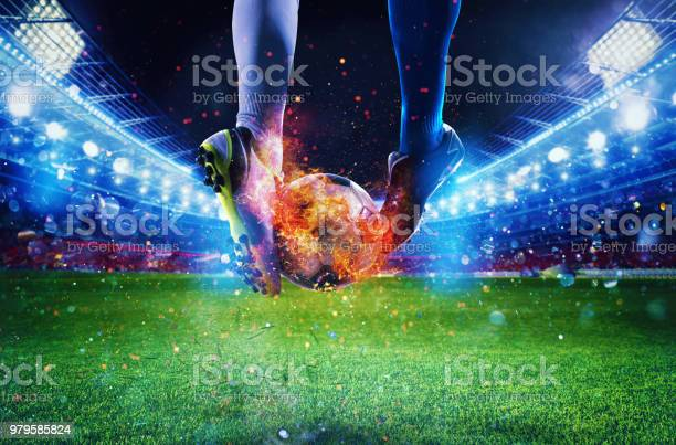 Photo of Soccer players with soccerball on fire at the stadium during the match