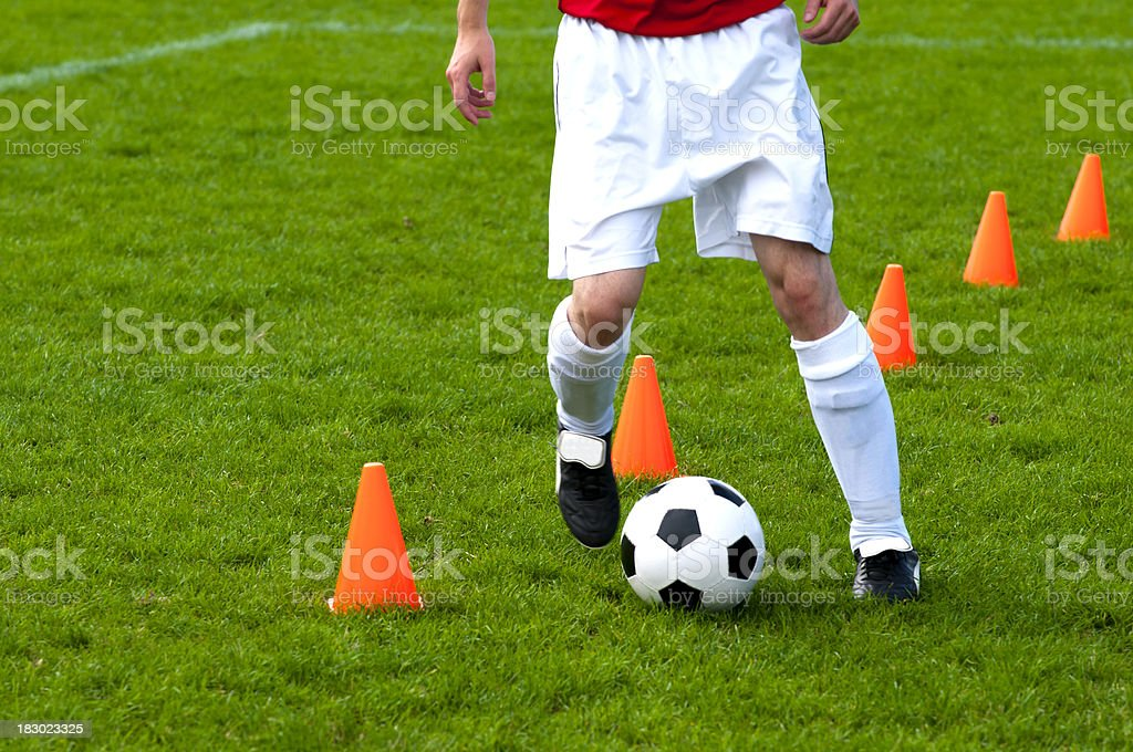 Soccer Practice Drills with soccer player running with football stock photo