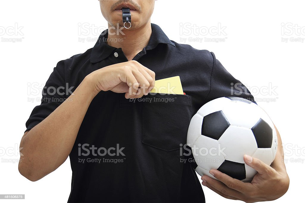 soccer referee hand holding yellow card and blow a whistle stock photo