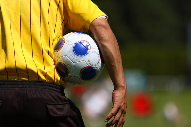 Soccer Referee A soccer referee holding a soccer ball. referee stock pictures, royalty-free photos & images