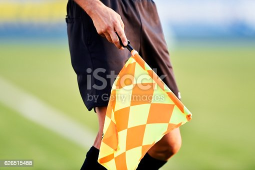 istock Soccer referee with offside flag 626515488