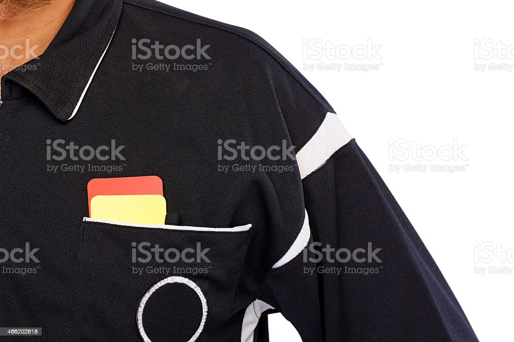 Soccer referee with red and yellow card stock photo