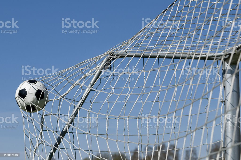 Soccer scoring as the ball hits the net royalty-free stock photo
