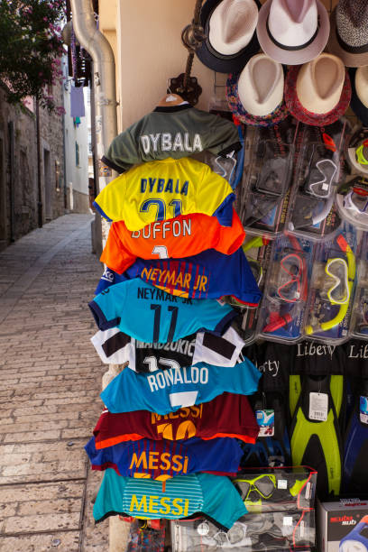 soccer shirts hang outside a shop - cristiano ronaldo imagens e fotografias de stock