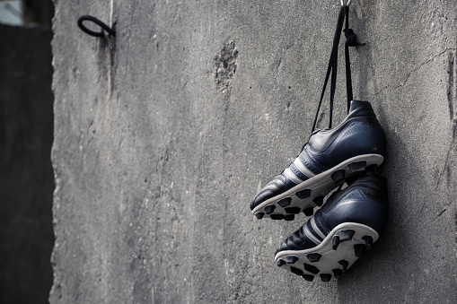 Soccer shoes hanging.