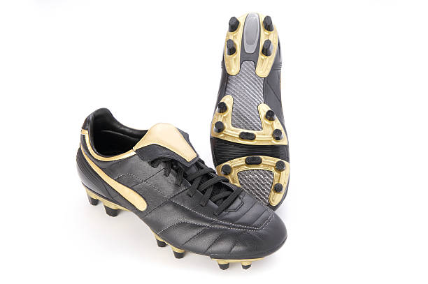soccer shoes isolated on white  studded stock pictures, royalty-free photos & images