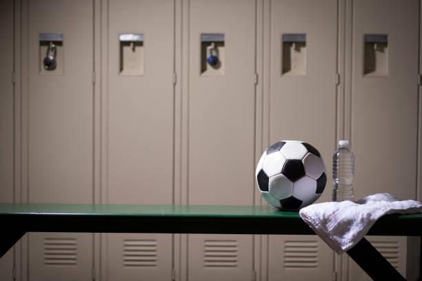 Soccer sports equipment in school gymnasium locker room. stock photo