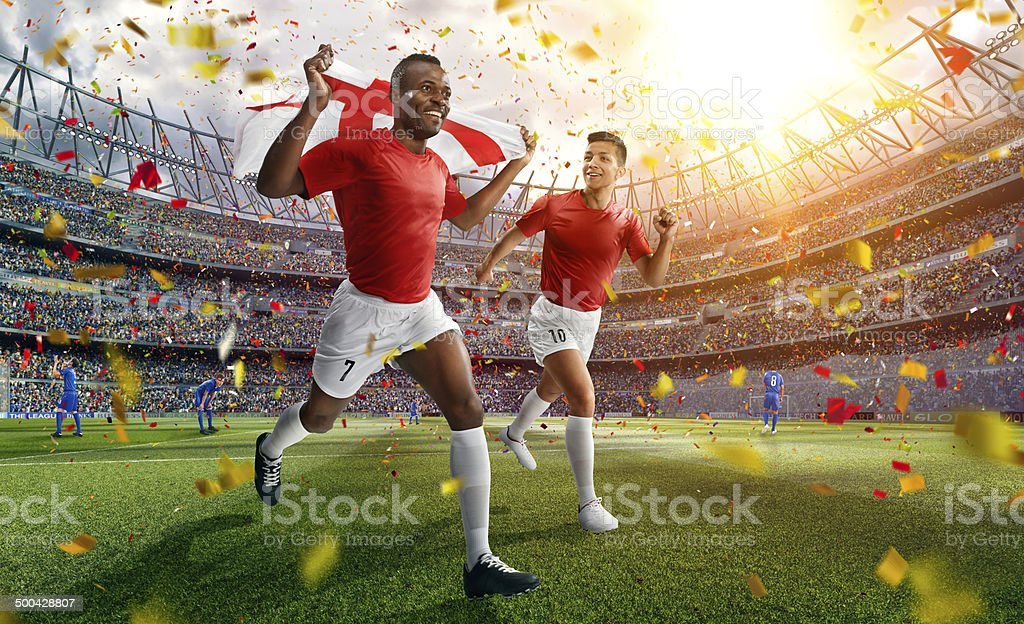Soccer stadium and soccer players are happy after victory stock photo
