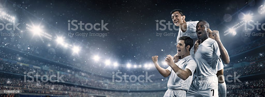Soccer stadium and soccer players happy after victory stock photo