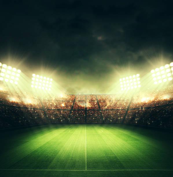 Estádio de futebol e as luzes brilhantes - foto de acervo