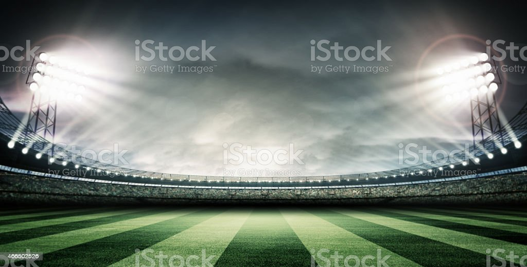 El estadio de fútbol y de las luces brillantes - foto de stock