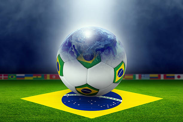 Soccer stadium, ball, globe, flag of Brazil stock photo