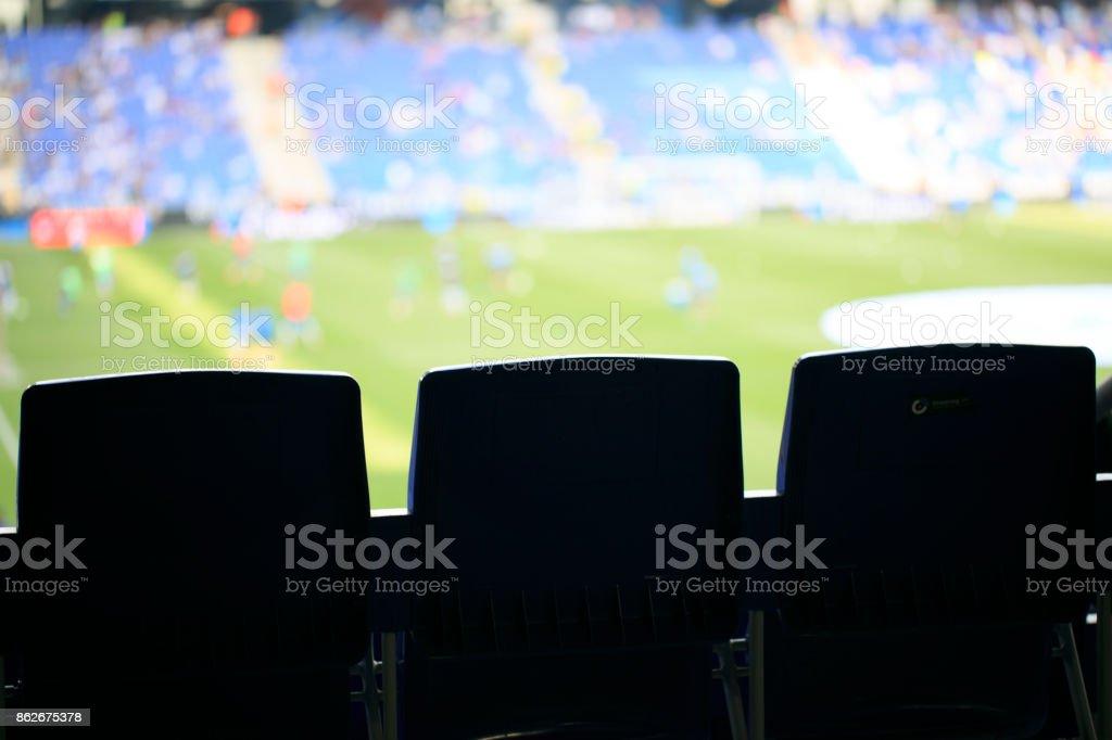 Soccer stadium seats stock photo