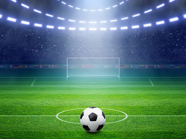 soccer stadium with illuminated field and arena - soccer field stock photos and pictures