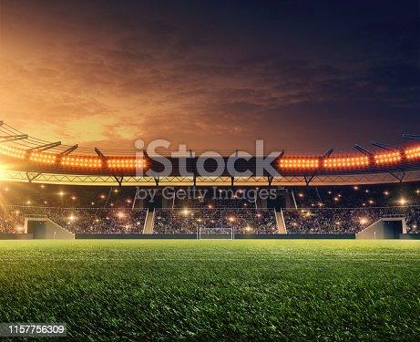 soccer stadium with illumination, green grass and dramatic night sky