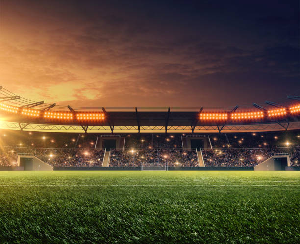 soccer stadium with illumination and night sky soccer stadium with illumination, green grass and dramatic night sky soccer field stock pictures, royalty-free photos & images
