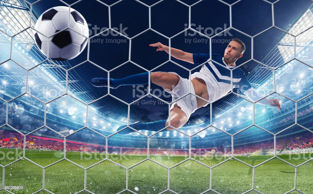 Soccer striker hits the ball with an jumping kick foto stock royalty-free