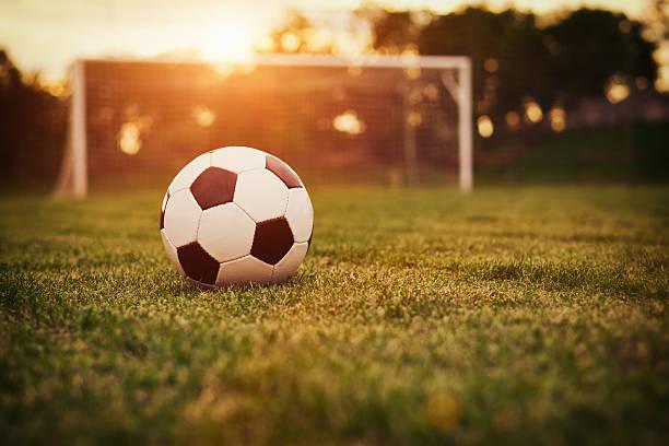 soccer sunset - soccer goal stockfoto's en -beelden