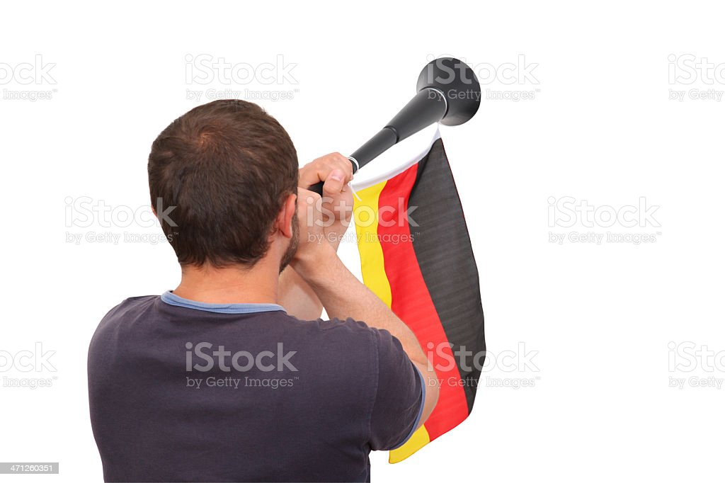 Soccer supporter blowing a Vuvuzela royalty-free stock photo