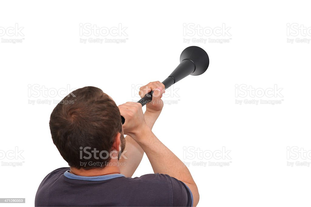 Soccer supporter blowing a Vuvuzela stock photo
