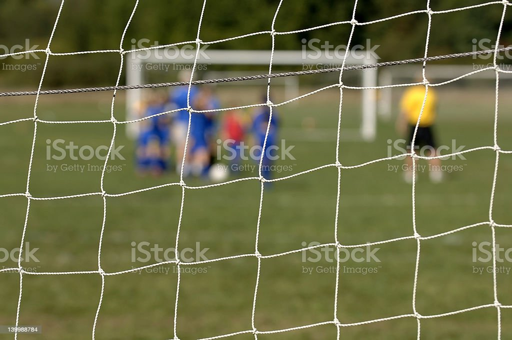 Soccer team beyond the net royalty-free stock photo