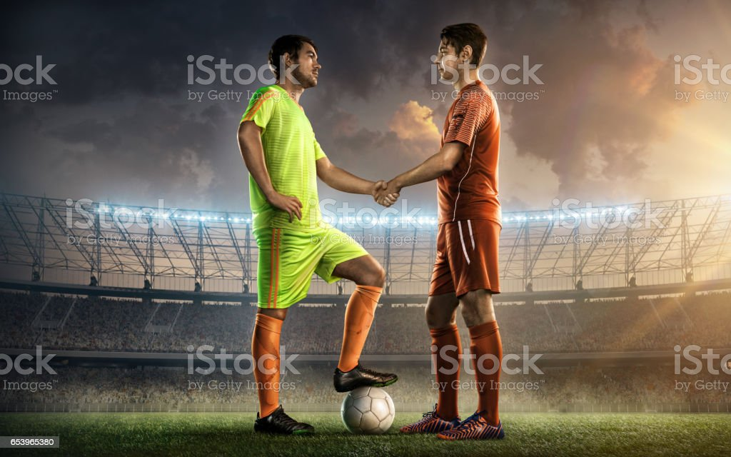 soccer team captains shaking hands stock photo