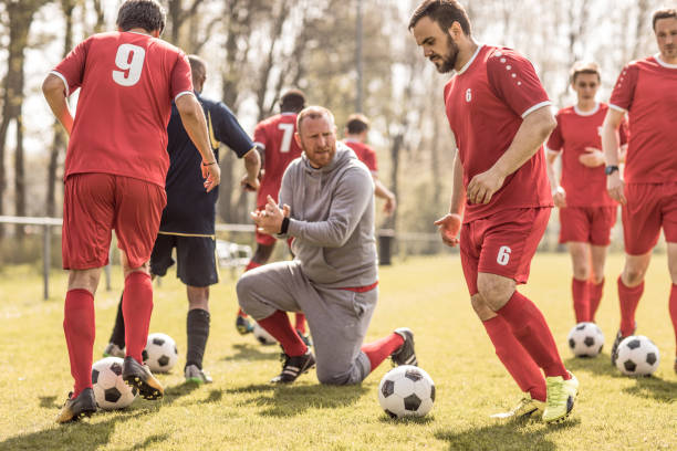 A soccer team during an intense soccer football training session with the coaching team stock photo