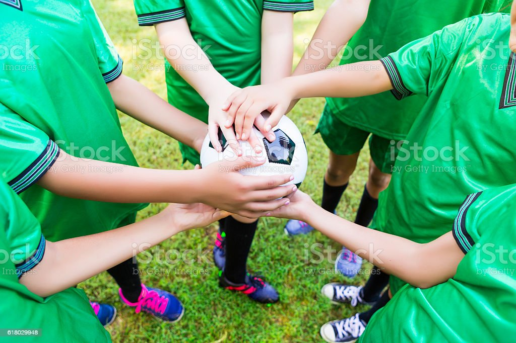 Soccer team holds ball before game stock photo