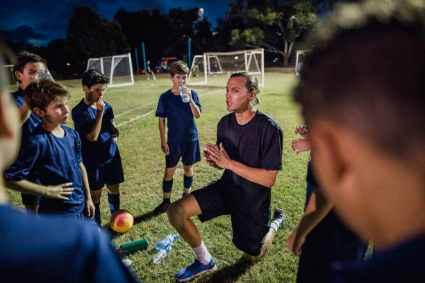 soccer team meeting - coach stock photos and pictures