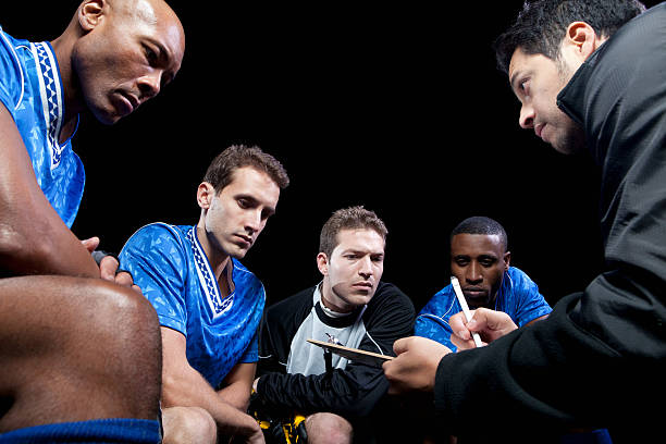 soccer team planning game with coach - coach stock photos and pictures
