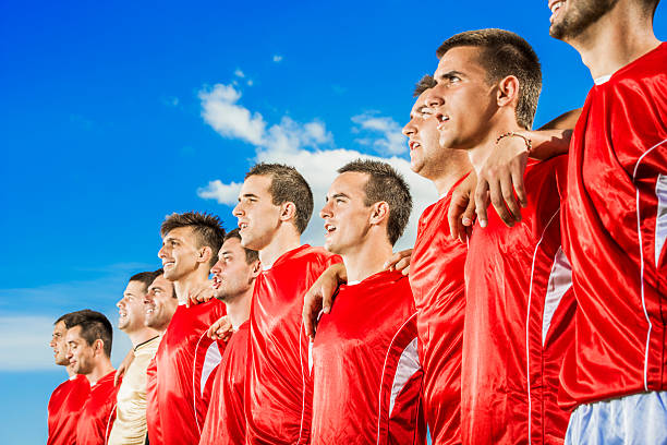 soccer team singing national anthem. - national anthem stock photos and pictures