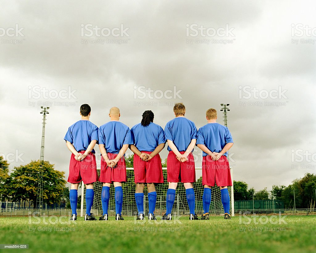 Soccer team standing in row royalty-free stock photo