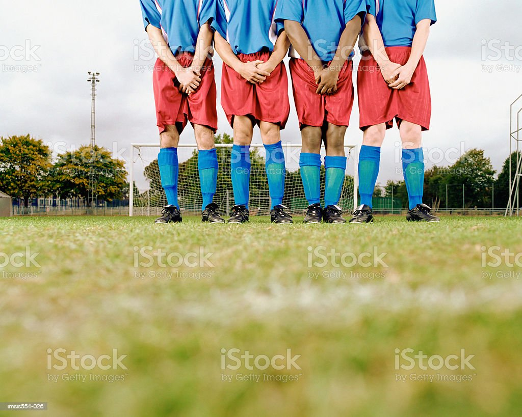 Soccer team standing in row royalty free stockfoto