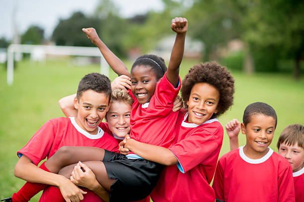 soccer team victory - sports team stock photos and pictures