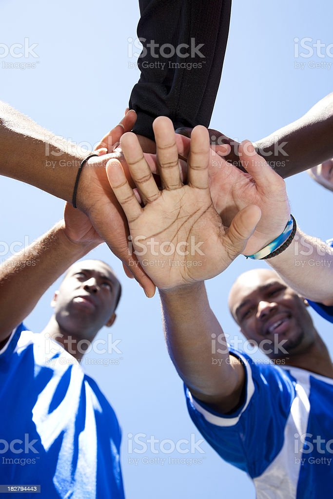 Soccer Team With Hands Together Before Game Starts stock photo