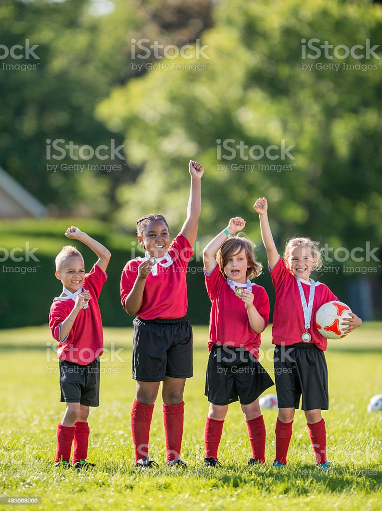 Soccer Teammates Cheering Victoriously stock photo