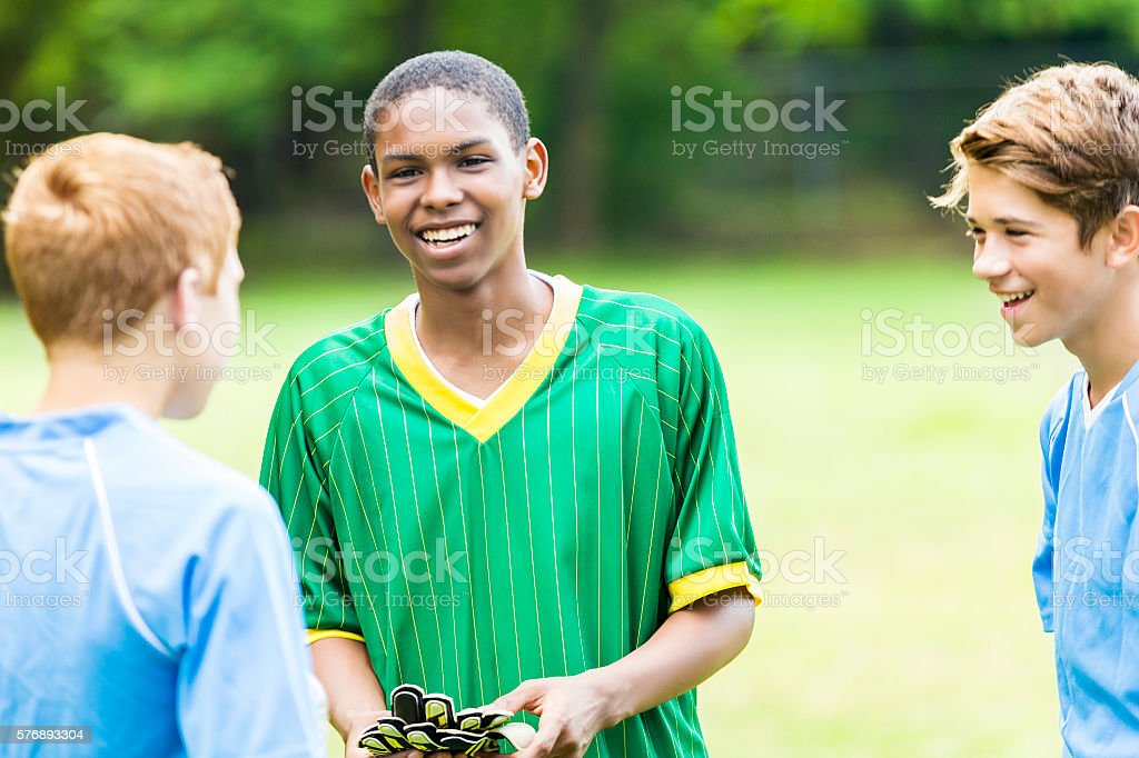 Soccer teammates talks with opposing team stock photo
